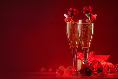 champagne glasses, hearts and scarlet roses