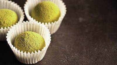 Homemade truffles with matcha tea powder,copyspace