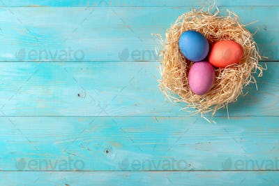 Easter concept, copy space, top view, blue wood