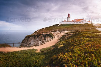 Travel to Portugal Sintra Region. View of the light house at Cabo da Roca or Cape Roca in sun light