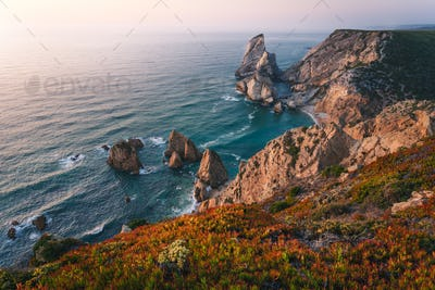 Praia da Ursa. Sintra Region. Portugal. Ursa Beach scenic seascape with sea stacks and cliffs in