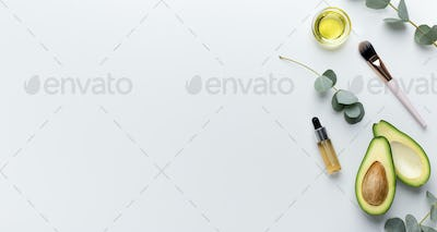 Ingredients for home spa top view: honey, avocado,essential oil