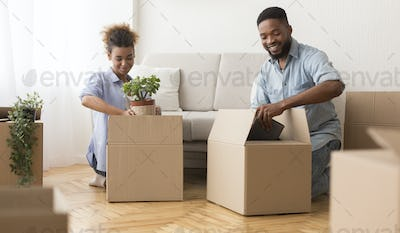 African American Spouses Preparing For Relocation Packing Stuff Indoor