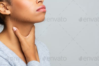 Black woman touching her neck, having pain in throat