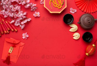 Chinese New Year flat lay red background with assorted festival decorations