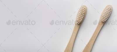 Two eco natural bamboo toothbrushes on white background