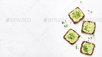 Trendy sandwiches with avocado spread and microgreen