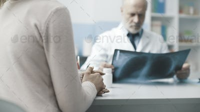 Radiologist checking a patient's X-ray image