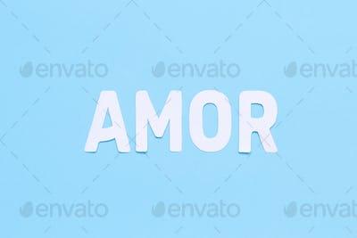 Word AMOR on a light blue background