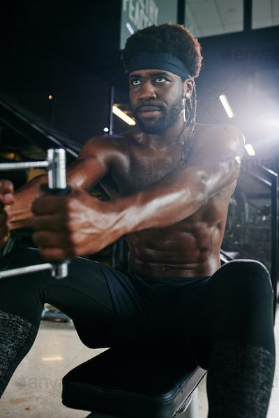 African Man Using Fitness Machine