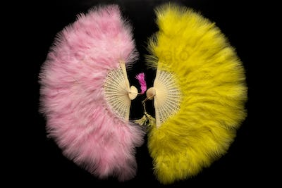Yellow and pink Chinese folding fan on a black background