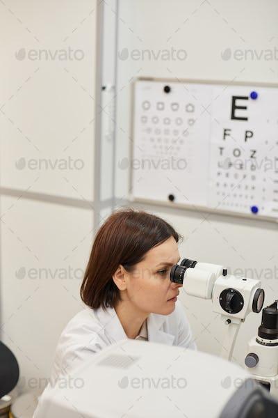 Female Ophthalmologist Using Vision Test Machine
