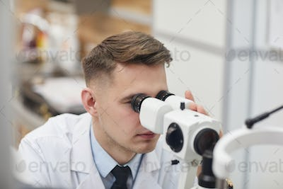 Male Ophthalmologist Using Vision Test Equpment