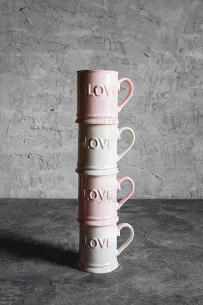 pink cups with love, gray background. concept of romantic meeting, love, romantic breakfast