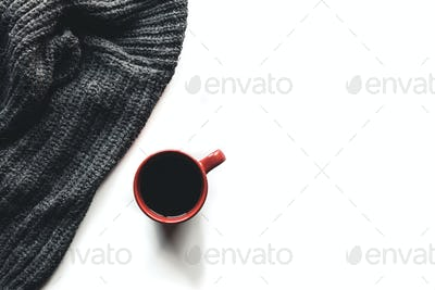 Autumn composition. Cup of coffee, sweater on white background. Autumn