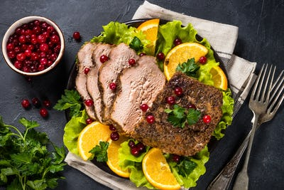 Baked pork meat with cranberry and oranges