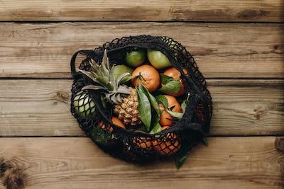 Fresh seasonal fruits in eco cotton bag