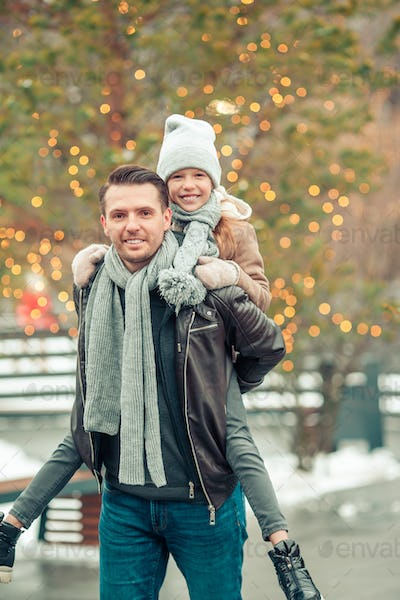 Family winter sport. Father and daughter on winter day