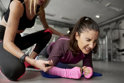 Young woman during hard workout at gym