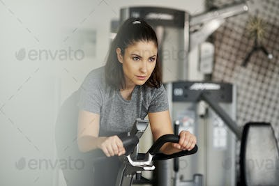 Woman working out with exercise bike