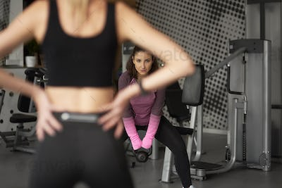 Woman practicing with kettlebell at the gym