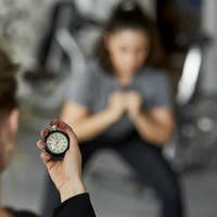 Close up of fitness instructor checking the time