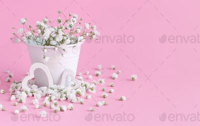 Small white flowers and hearts on a lavender background