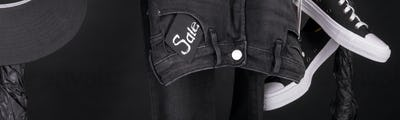 Banner with Sale sign, Black and white snaekers, cap and pant, jeans
