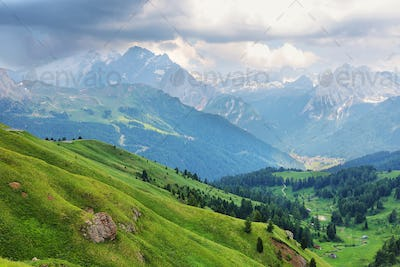 View of mountains and Canazei village from Sella pass, Dolomites Alps, Italy, Europe