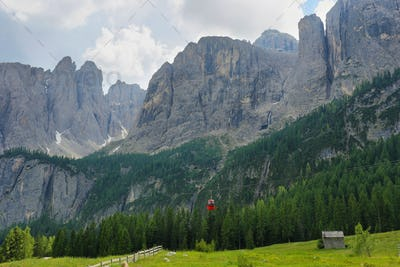 View of mountains and a cablecar in Gardena pass, Dolomites Alps , Italy, Europe