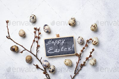 Easter background with quail eggs and pussy willow