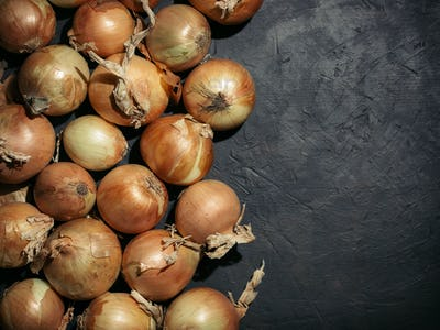 Fresh onions. Onions background. Low key