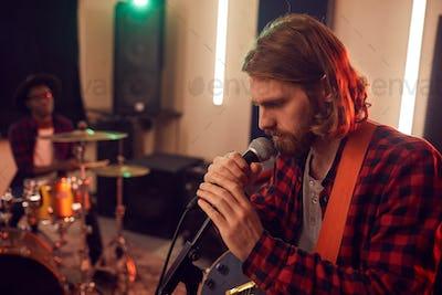 Handsome Young Man Singing in Studio