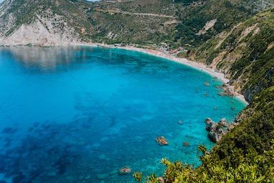 Myrtos beach. Clear azure blue sea water in beautiful bay. Favorite tourist visiting destination