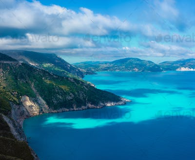 Picturesque rocky coastline on Kefalonia island. Amazing landscape with cloudscape and shadows on