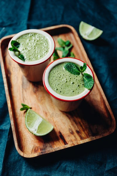 Two portions of green spinach smoothie