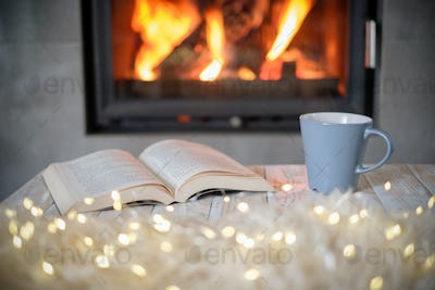 Hygge concept with book and tea