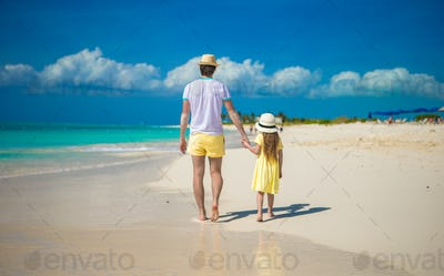 Little cute girl and happy father on tropical exotic beach
