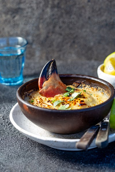 Baked crabmeat crab meat with cheese, cream and bread. Traditional dish of chilean coast.