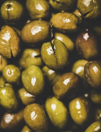 Flat-lay of fresh harvested shiny seasonal pickled green Mediterranean olives