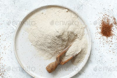 Teff flour in a plate with a spoon