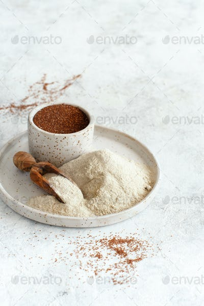 Teff flour and teff grain close up