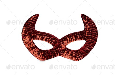 Gold carnival mask with beads isolated on a white background