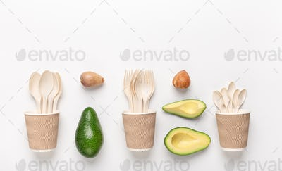 Creative flat lay of plastic disposable tableware in wooden cups