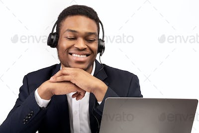 Happy black receptionist working in call centre
