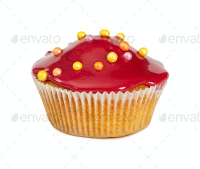 Muffin with red glossy glaze and colored sprinkles