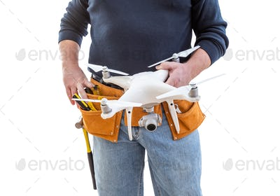 Construction Worker and Drone Pilot With Toolbelt Holding Drone Isolated on White Background
