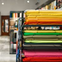 Fabric on shelves in textile store, nobody