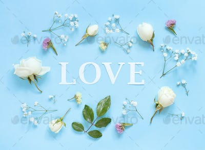 Flowers and word LOVE on a light blue background