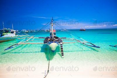 Filipino boat in the turquoise sea, Boracay, Philippines